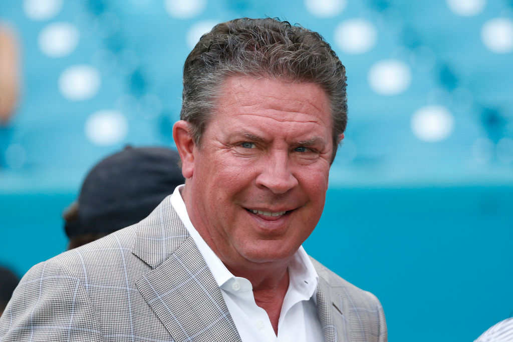 Former Miami Dolphins quarterback Dan Marino watches the team warm up