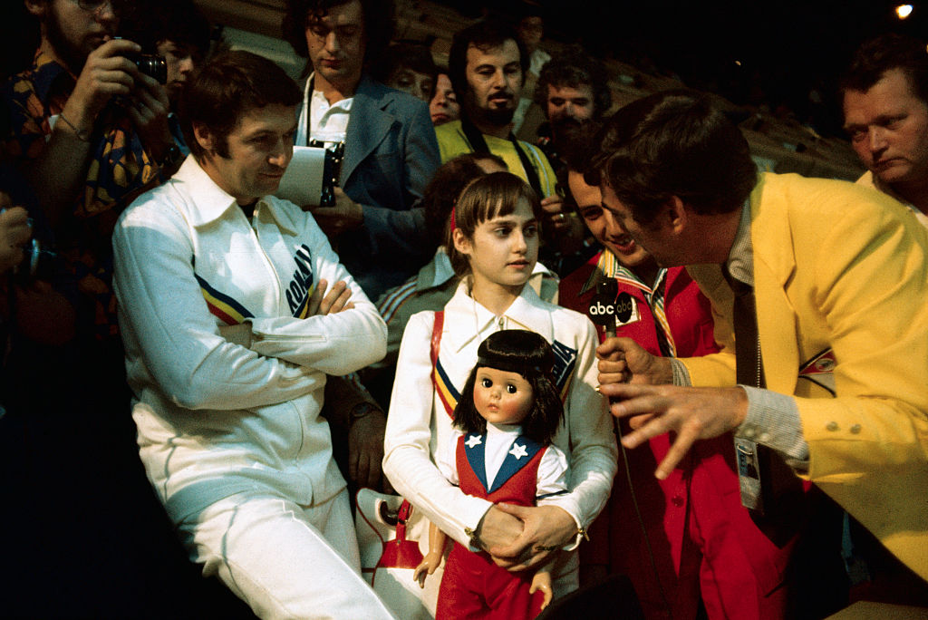 nadia comaneci with press after seven olympic perfect scores