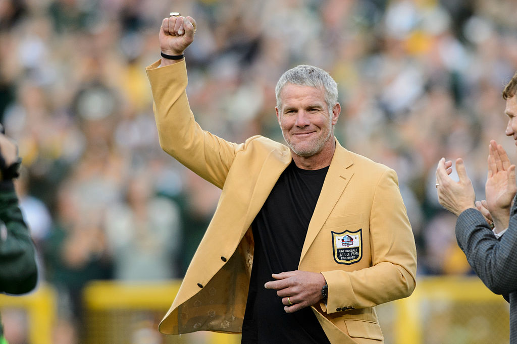 Former NFL quarterback Brett Farve looks on as he is inducted into the Ring of Honor