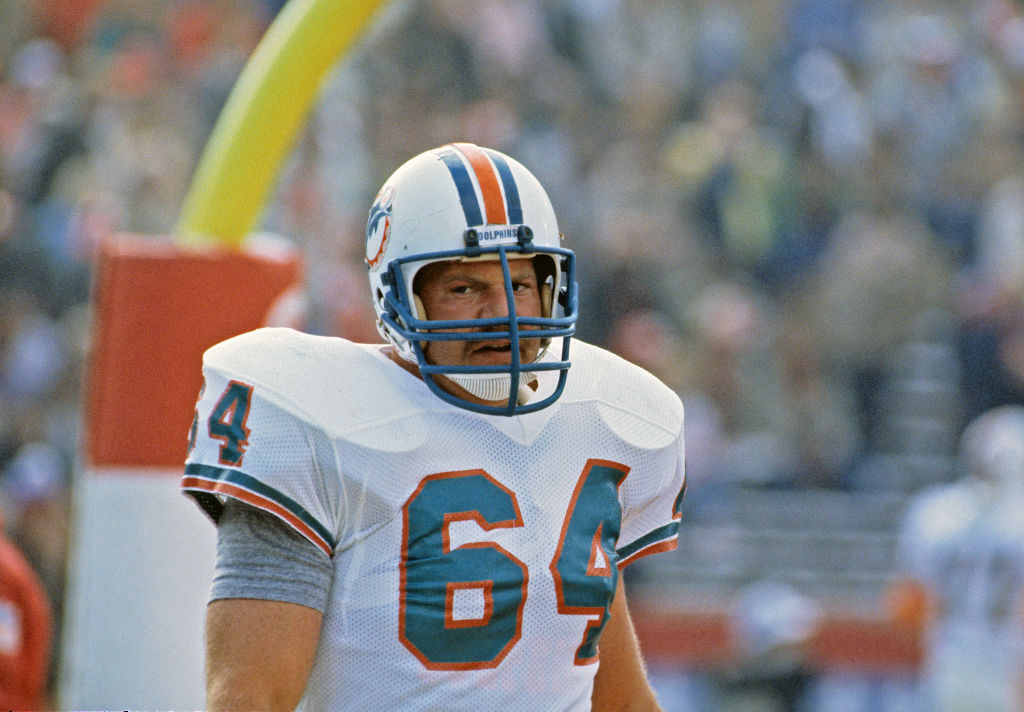 Offensive lineman Ed Newman #64 of the Miami Dolphins looks on from the field before the start of Super Bowl XIX