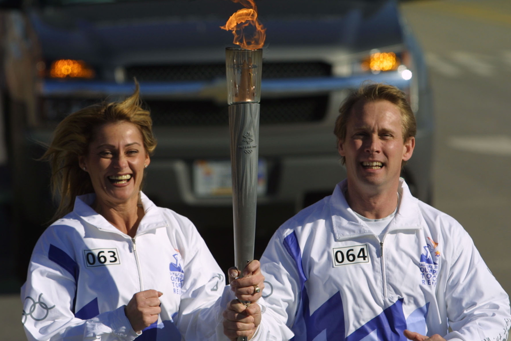 nadia comaneci and bart conner olympic torch