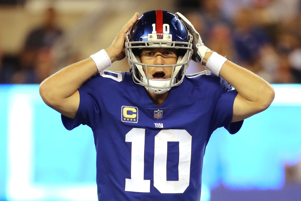 Eli Manning  calls a play in the fourth quarter against the Detroit Lions