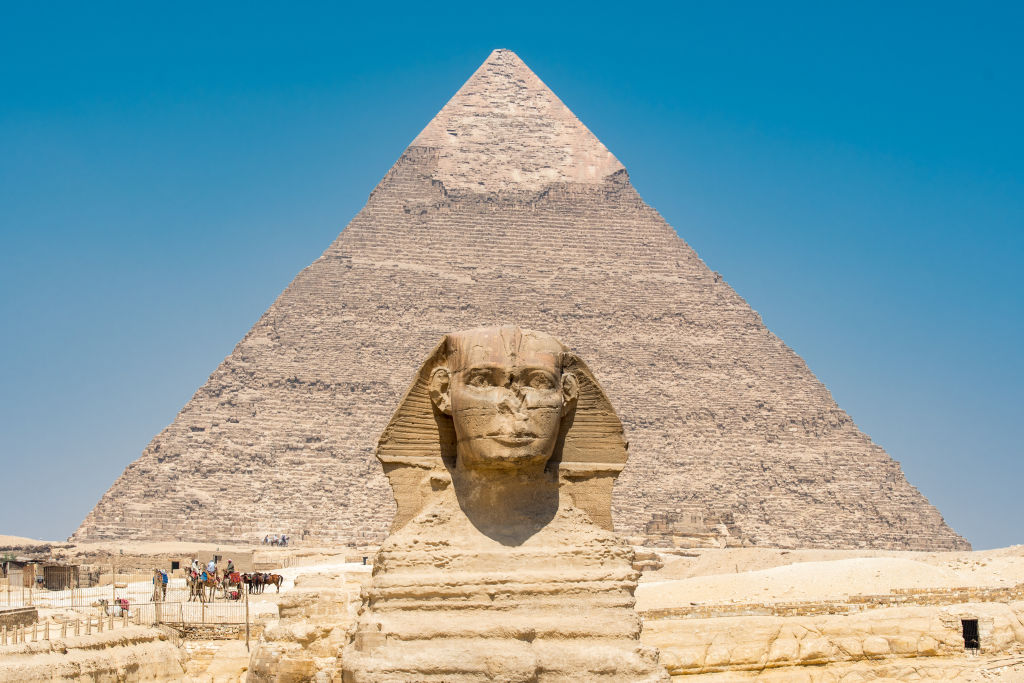 he Great Sphinx of Giza standing tall with the Great Pyramids of Giza in the background