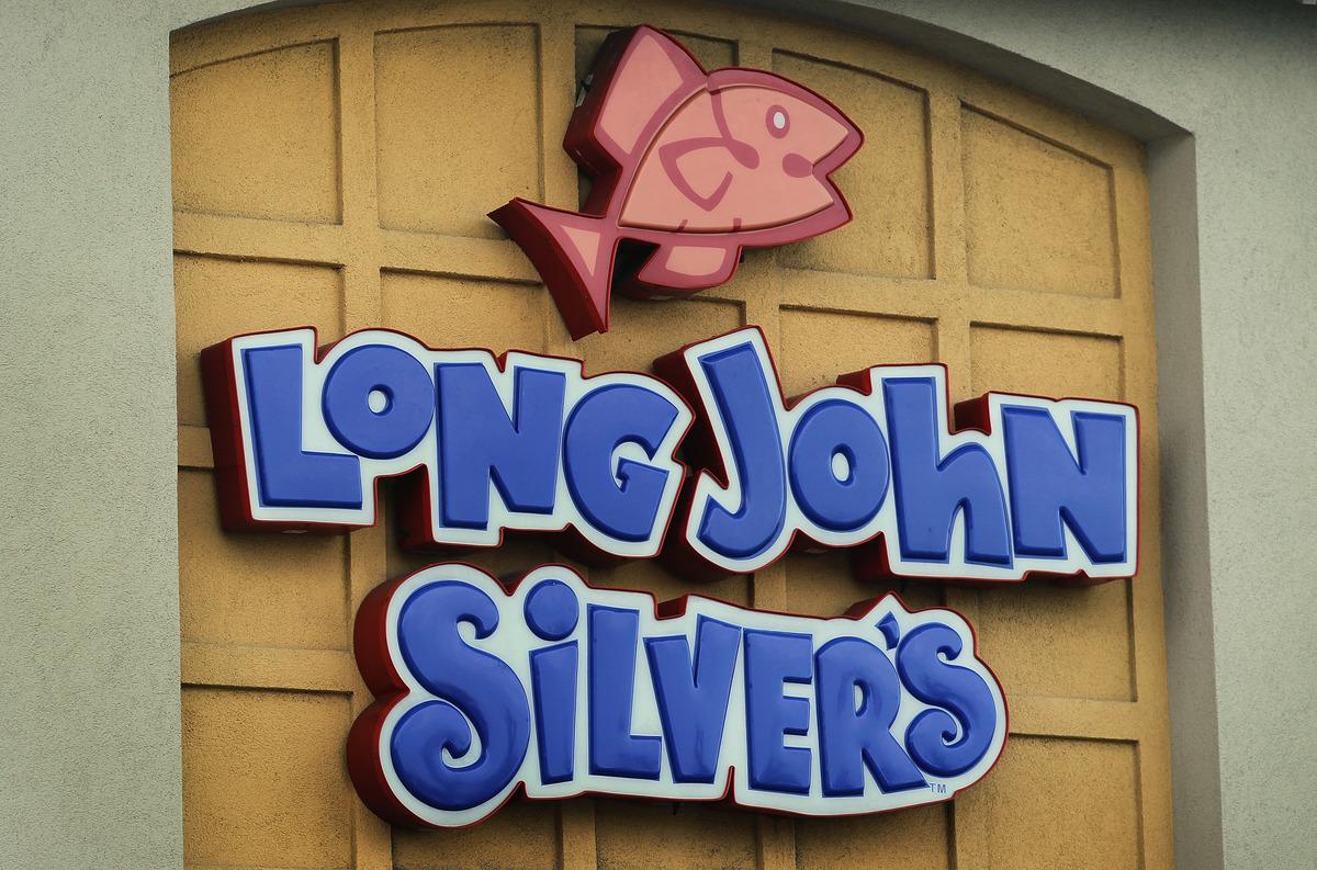 A sign hangs above a Yum Brands Long John Silver's restaurant