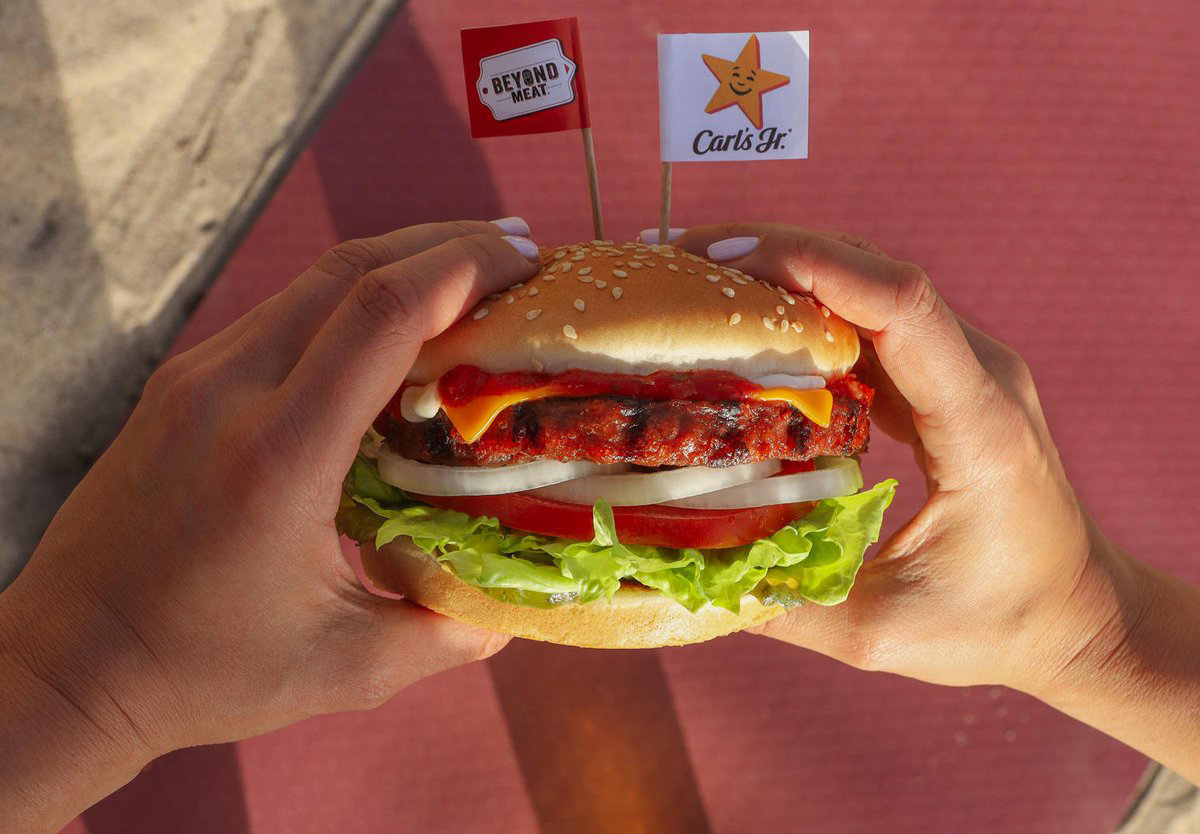 Person holding a Beyond Famous Star burger from Carl's Jr.