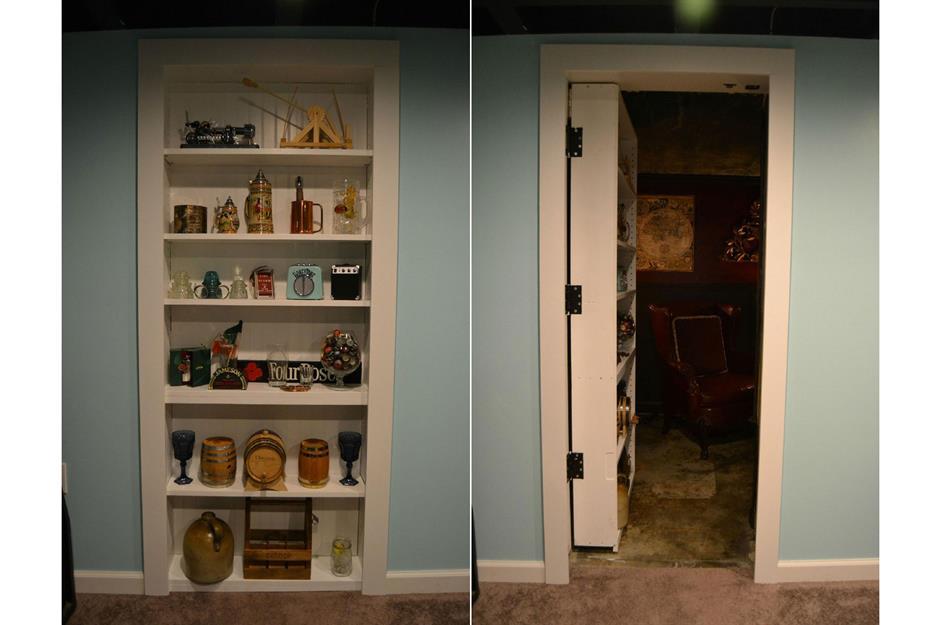 A bookcase is actually a door to a hidden room.