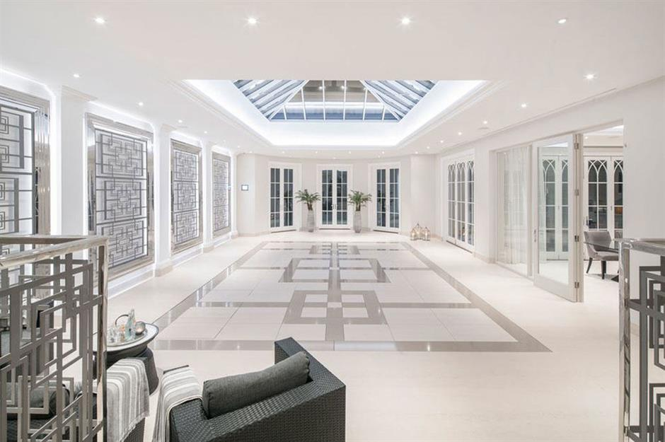 A large, white space features a skylight and recess lighting.