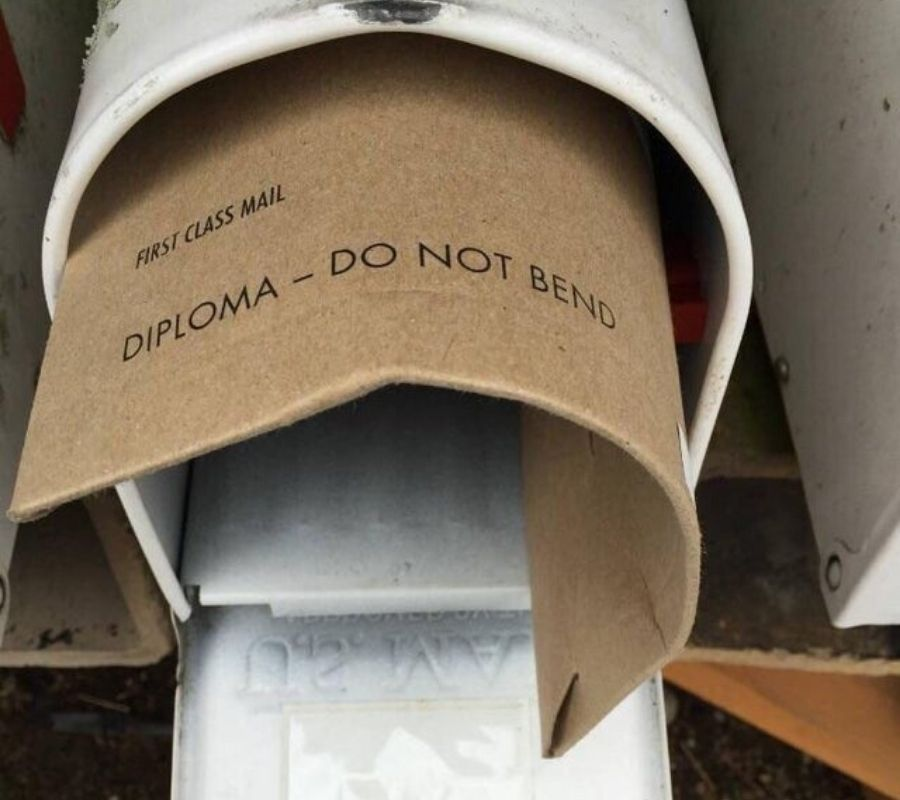 a bent diploma that says 'do not bend' on it