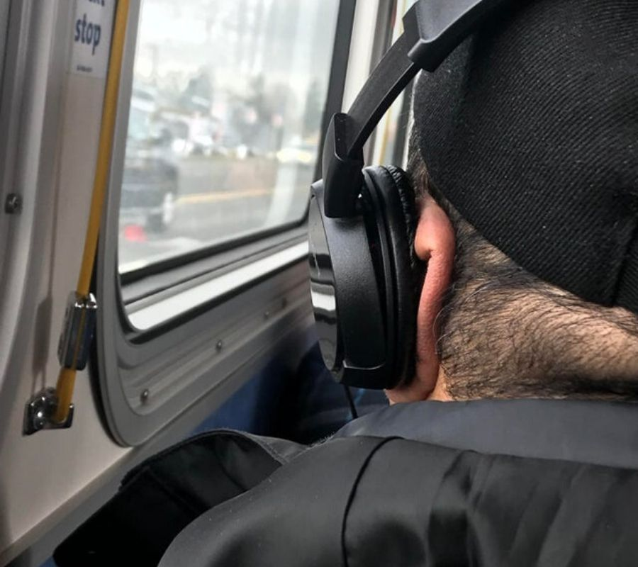 someone with their ear squished under a headphone