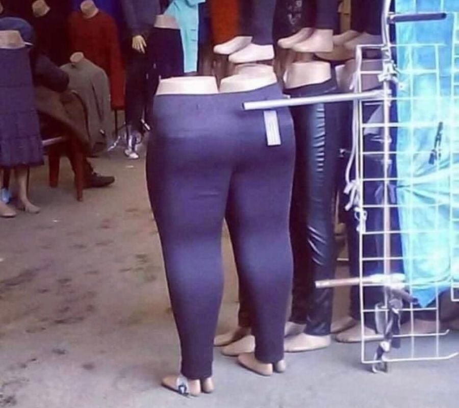 a pair of pants with a mannequin in each leg