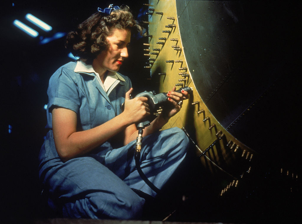 woman working on bomber