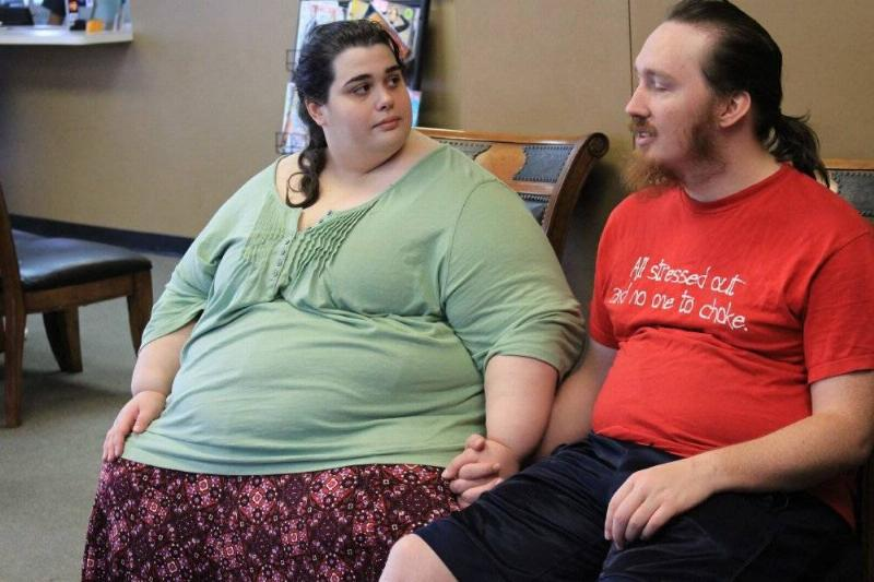 Amber holds hands with her boyfriend in the doctor's office waiting room.