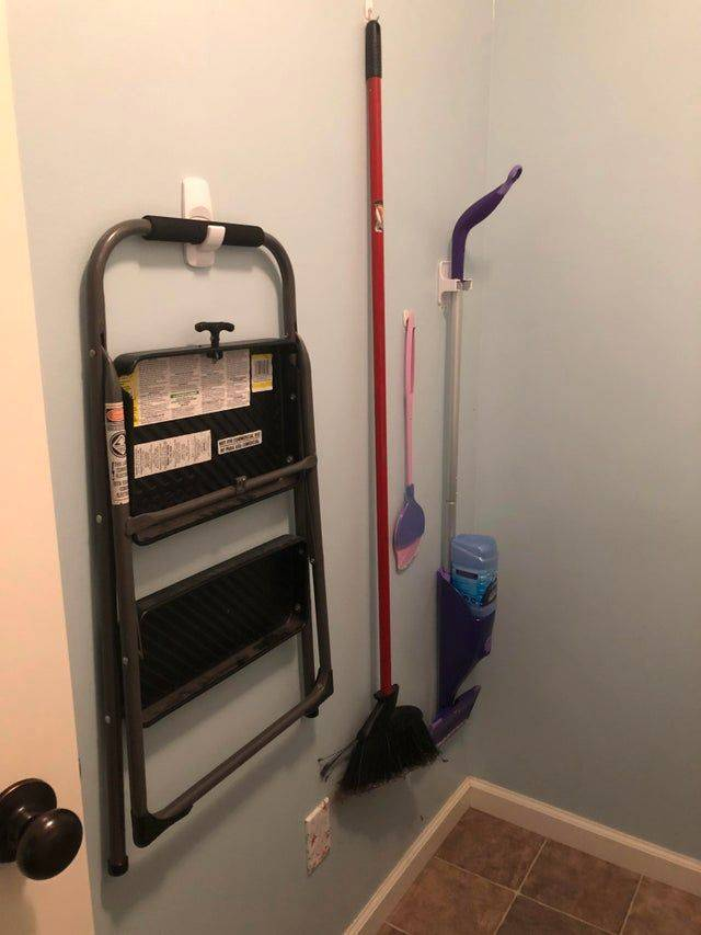 brooms hanging in closet