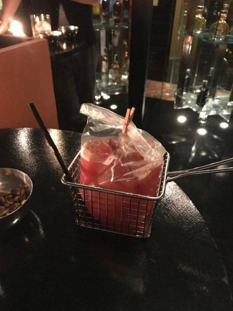 bloody mary served in plastic bag in a  basket