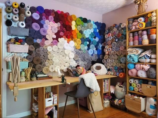 organized sewing room full of yarn