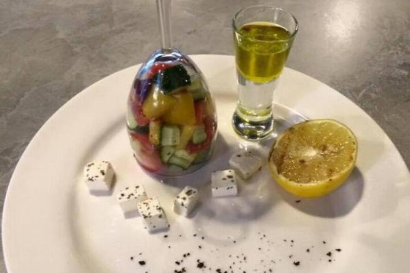 fancy salad inside wine and shot glasses