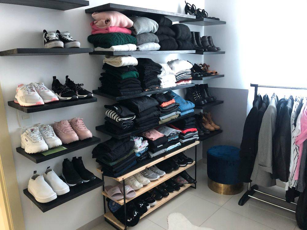 closet full of clothes organized
