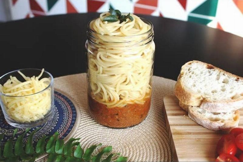 spaghetti in a jar with sauce at the bottom