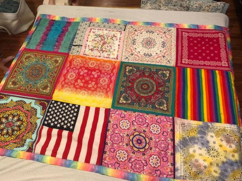 someone made a quilt out of the bandanas their old dog loved