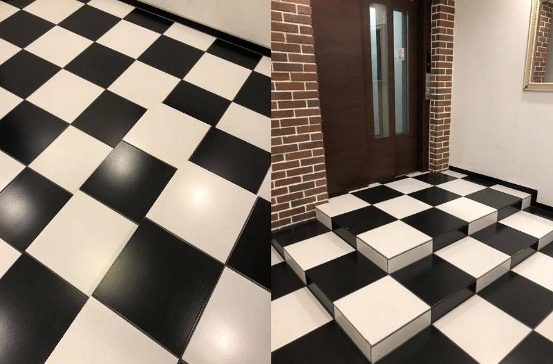 black and white checked stairs that are impossible to tell they're stairs