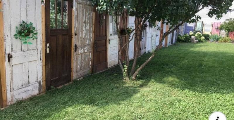 fence made of repurposed doors