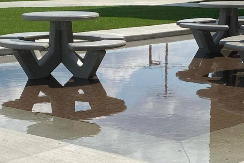 picnic tables at school lower in ground so the patio collects water