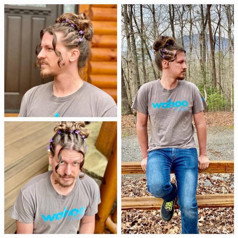boyfriend letting his girlfriend do his hair