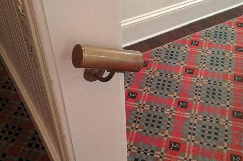small handrail on doorway that barely fits one hand