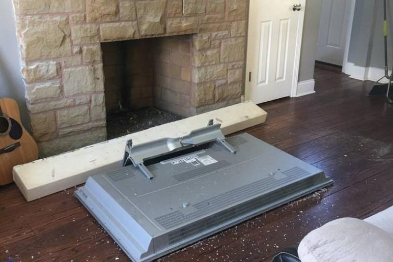tv that fell onto floor from wall mount above fireplce