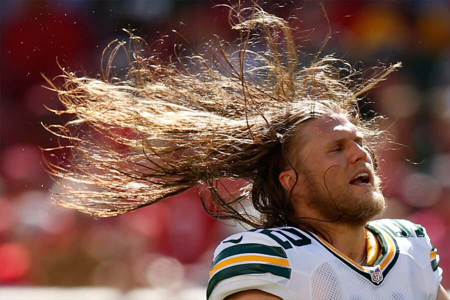 clay matthews whips his hair back and forth.jpg